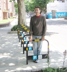 Cllr George Allan with new cycle stands